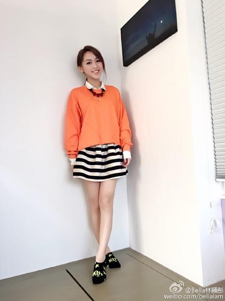 BellaLam_OrangeSweatshirt